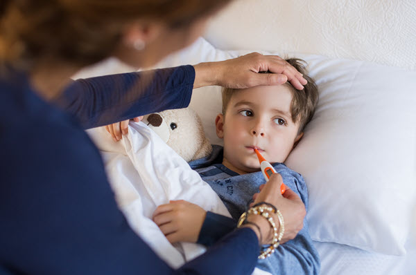 Boy with fever and flu